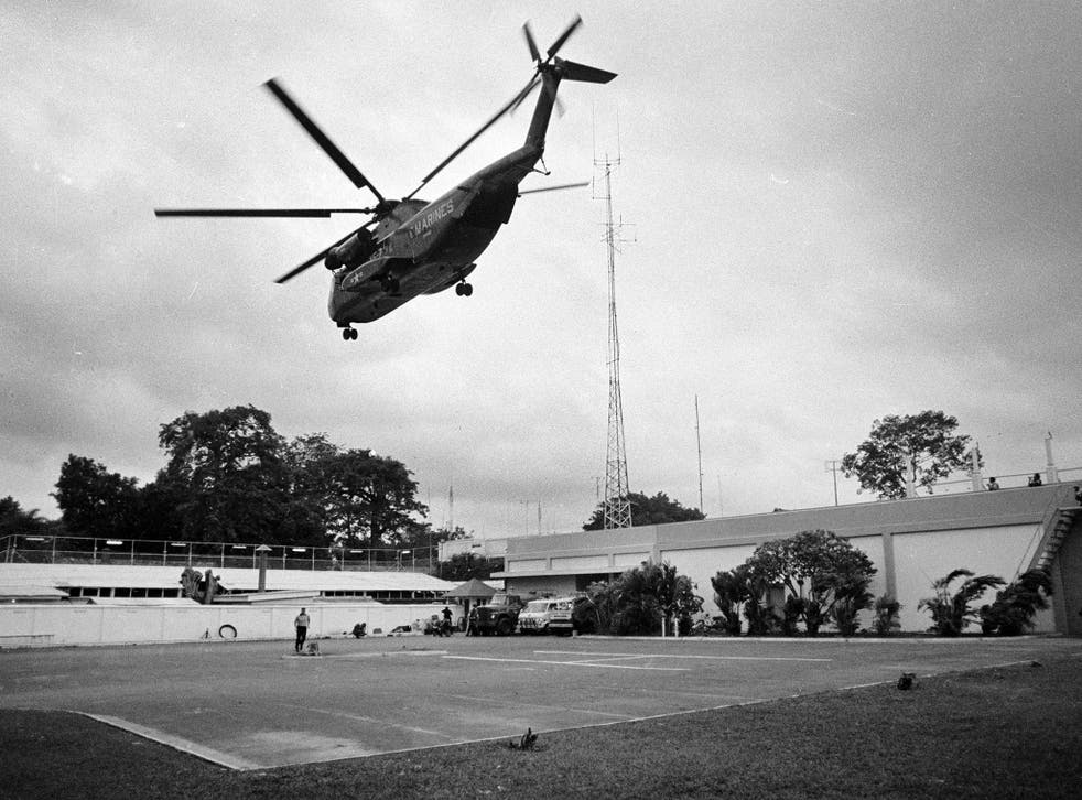 A helicopter lifts off from the US embassy in Saigon, Vietnam during last minute evacuation of authorized personnel and civilians on 29 April 1975