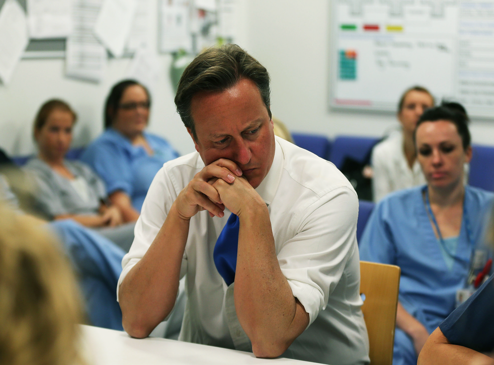 David Cameron talks to staff during a visit to the Salford Royal Hospital accident and emergency department