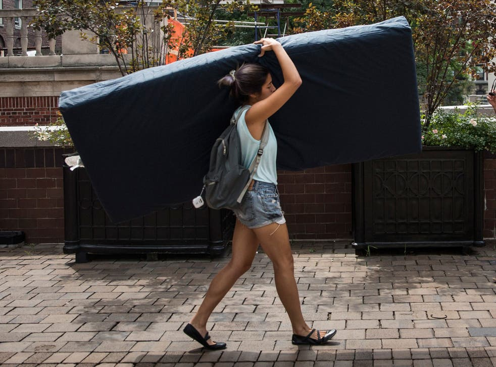 Emma Sulkowicz, a senior visual arts student at Columbia University, carries a mattress in protest