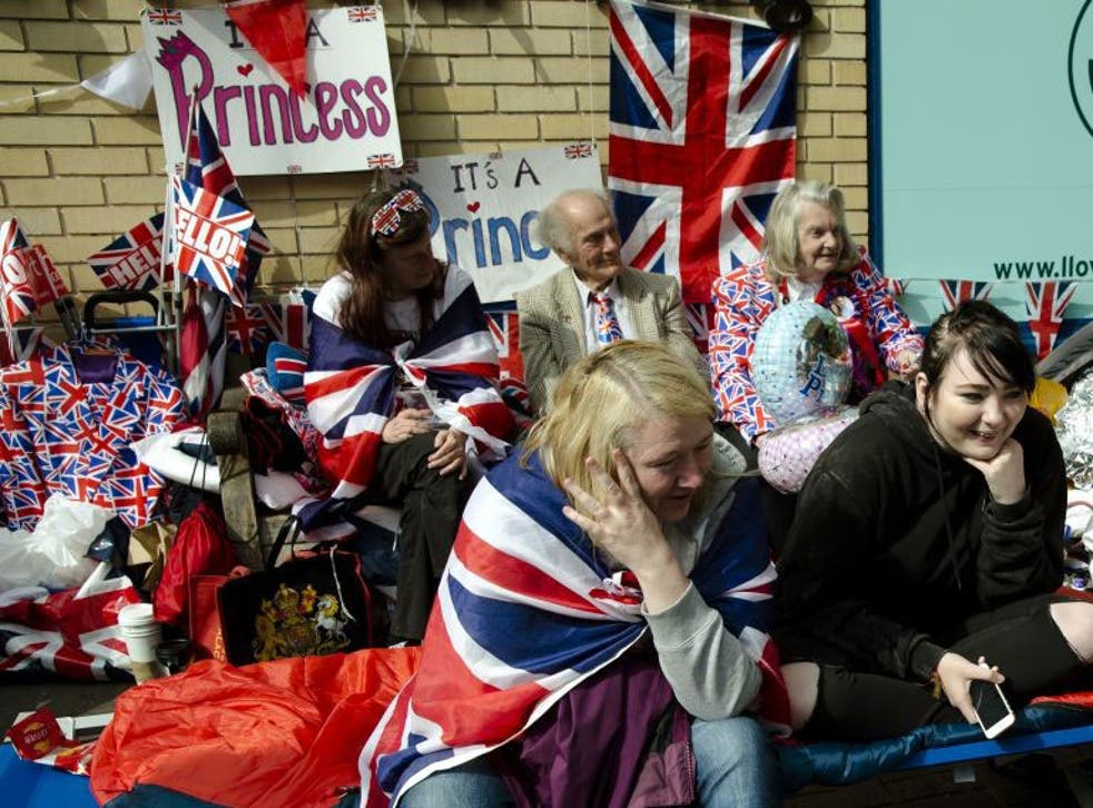 Royal fans covered with Union Jacks and royal memorabilia wait for Kate, Duchess of Cambridge to go into the Lindo wing at St Mary's Hospital to give birth to her second child