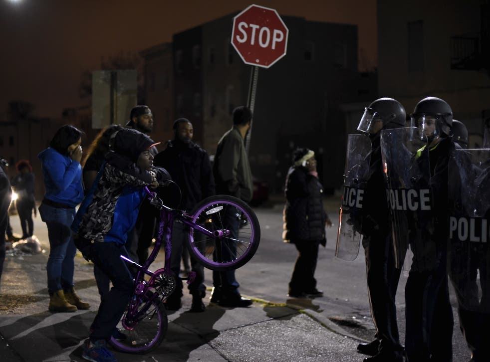 Police and protesters face off in Baltimore during unrest over the death in custody of Freddie Gray