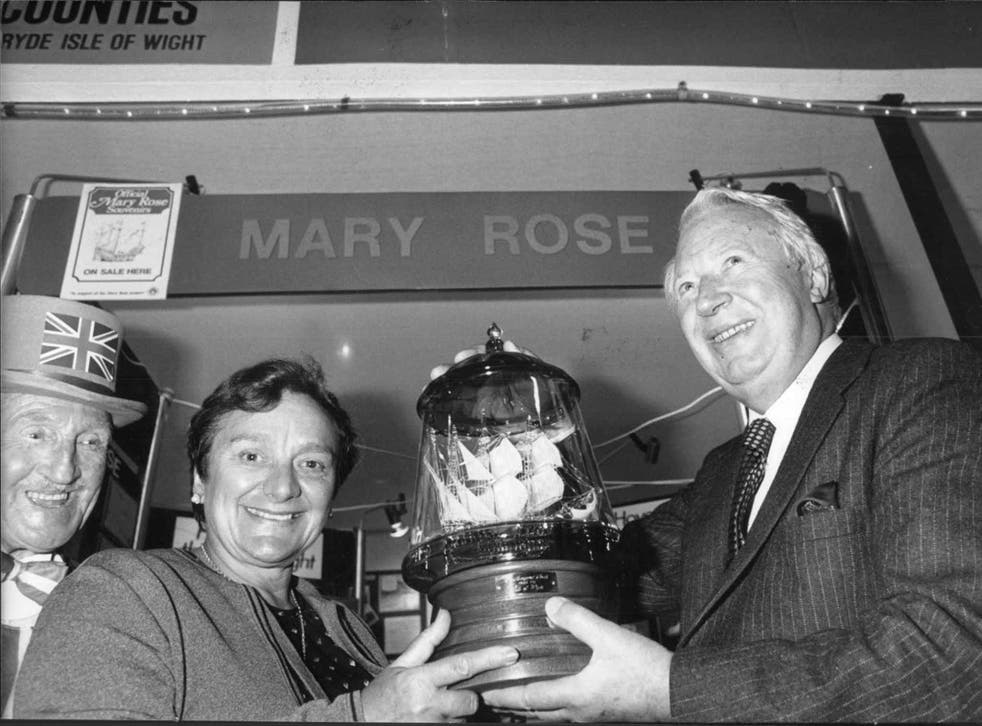 Rule is presented with a model of the 'Mary Rose' by the former Prime Minister, Edward Heath, at the 1983 Ideal Homes Exhibition