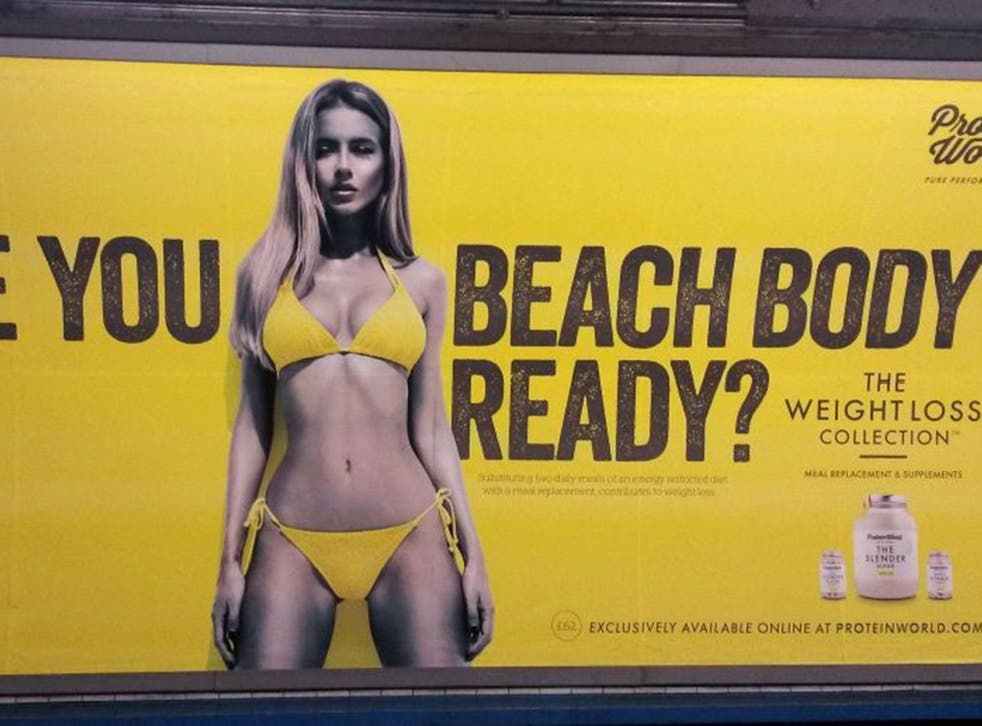 "A Protein World advert displayed in an underground station in London which says ""Are you beach body ready?""."