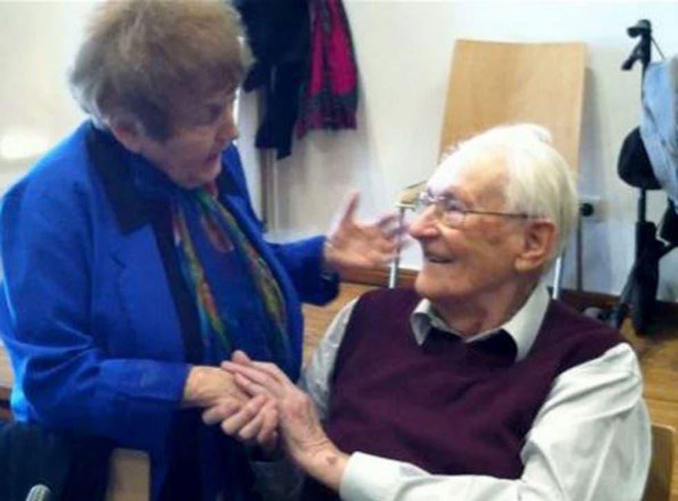 Auschwitz survivor Eva Kor during a conciliatory handshake with former SS member Oskar Groening