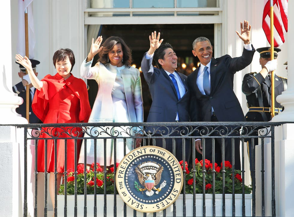 Barack Obama with Shinzo Abe at the White House, accompanied by Michelle Obama and Mr Abe's wife, Akie