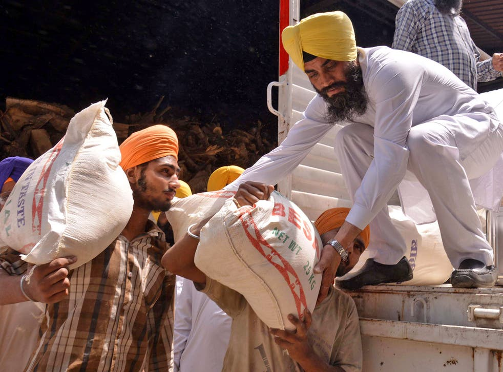Volunteers load relief material for Nepal in Amritsar, India