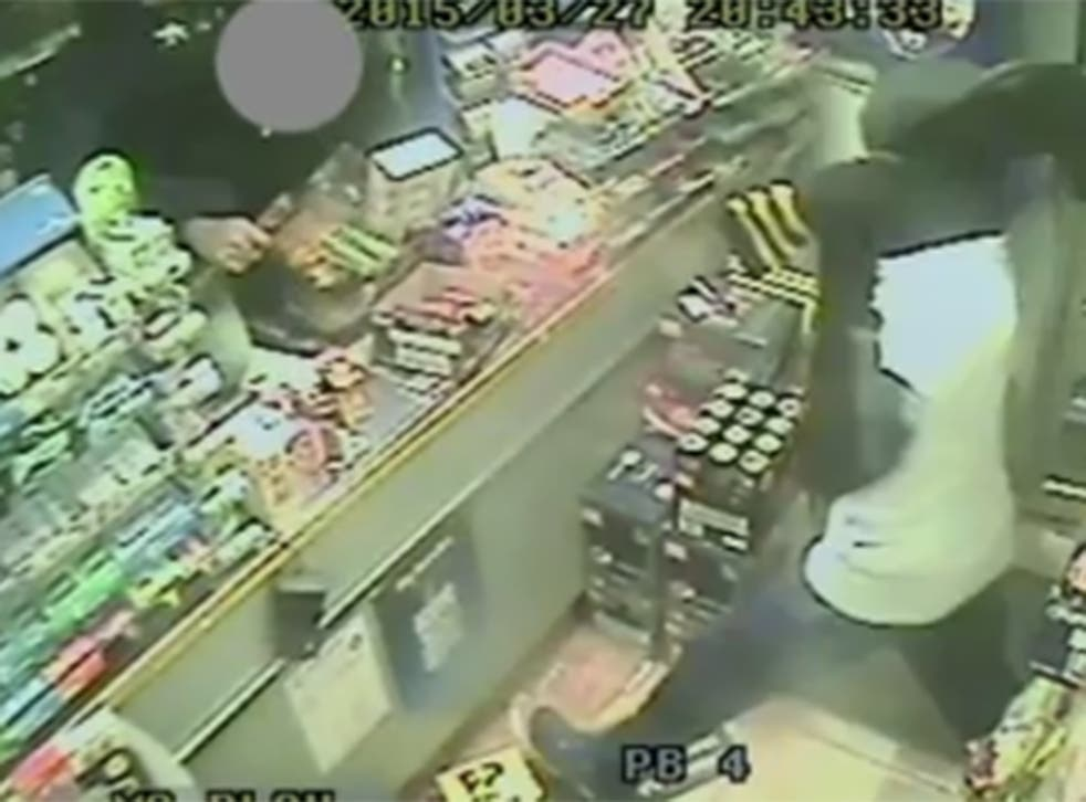 The moment one of the robbers attacks