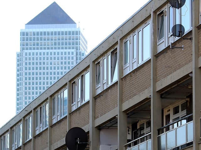 Canary Wharf rises above an area of council housing in Tower Hamlets