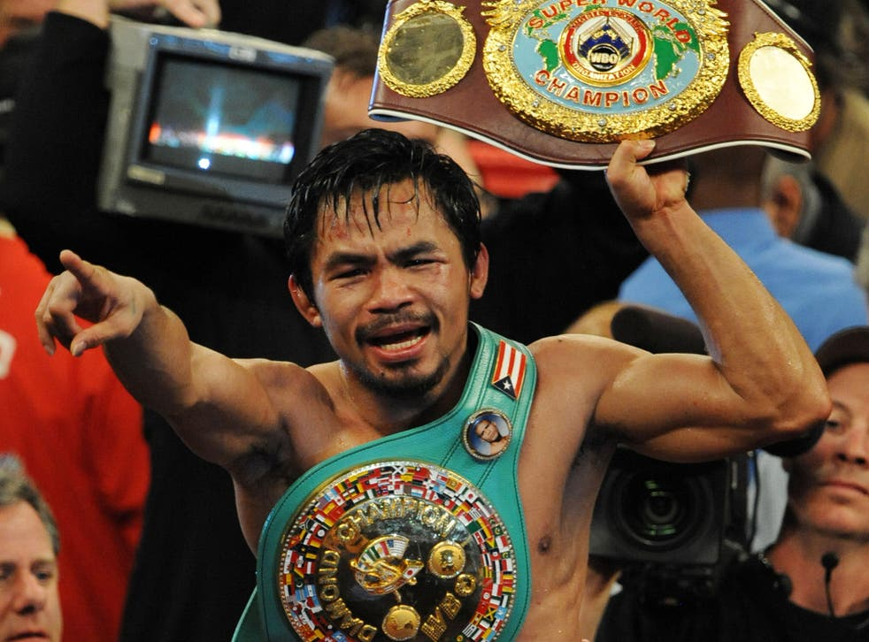Manny Pacquiao celebrates his victory over Miguel Cotto in November 2009