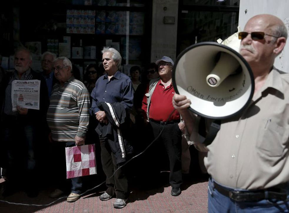 Greek pensioners stage a protest outside the Social Insurance Foundation headquarters against a government's decision to order state entities to park idle cash at the central bank
