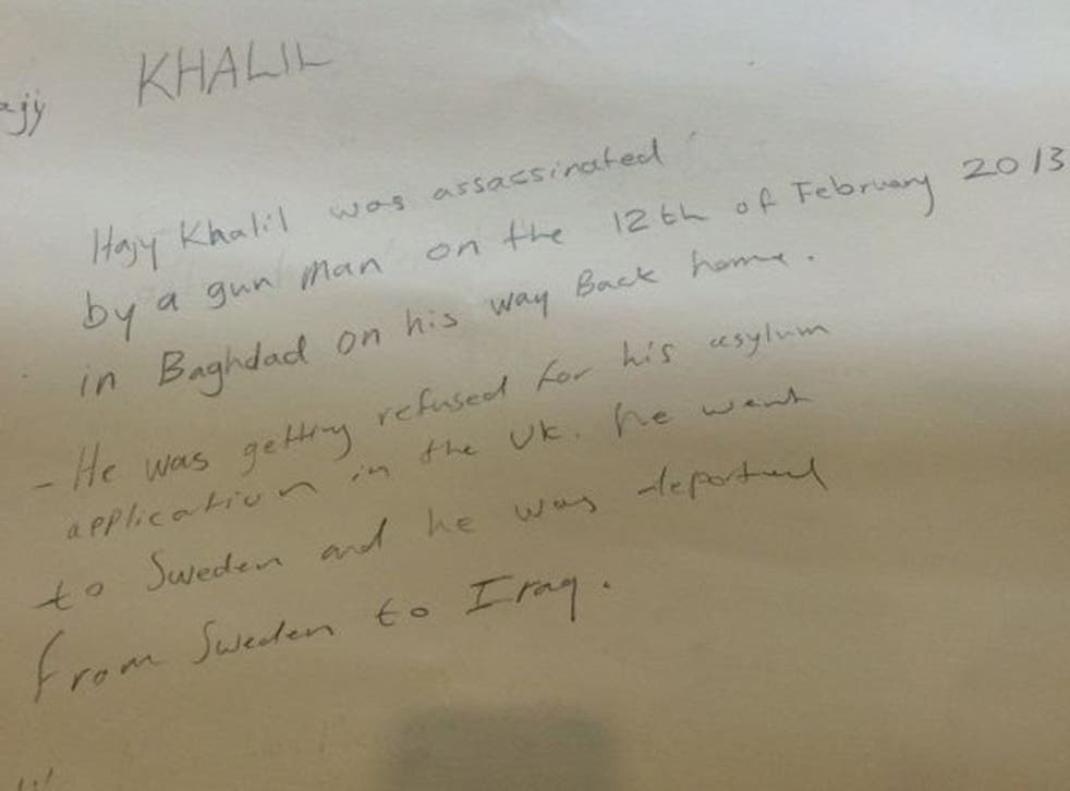 The inscription on the back of the picture revealing Mr Khalil had been shot dead in Iraq