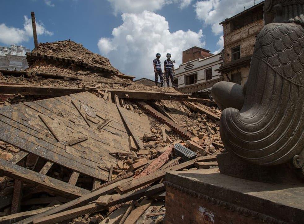 Rescuers look down on debris at Basantapur Durbar Square in Kathmandu last week