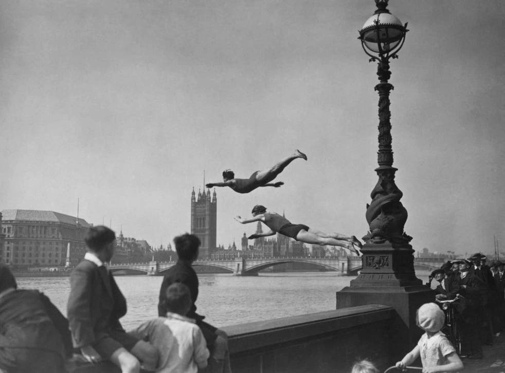 A capital idea: two divers jumping off the Embankment into the River Thames in London, near Westminster Bridge