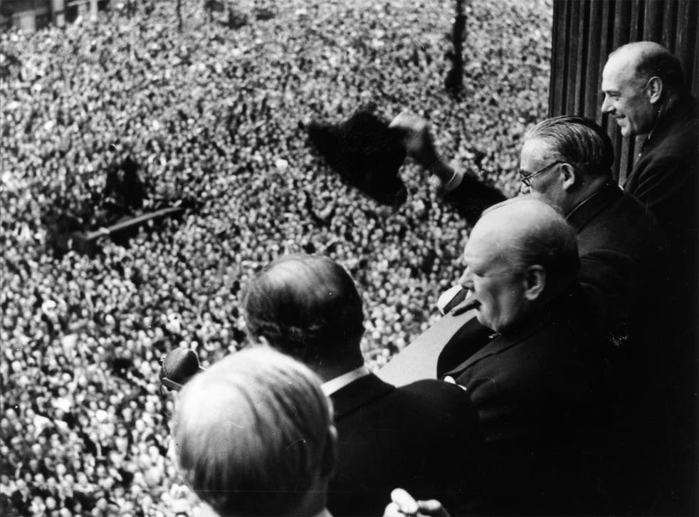 Churchill waves to the crowds in Whitehall (Getty)