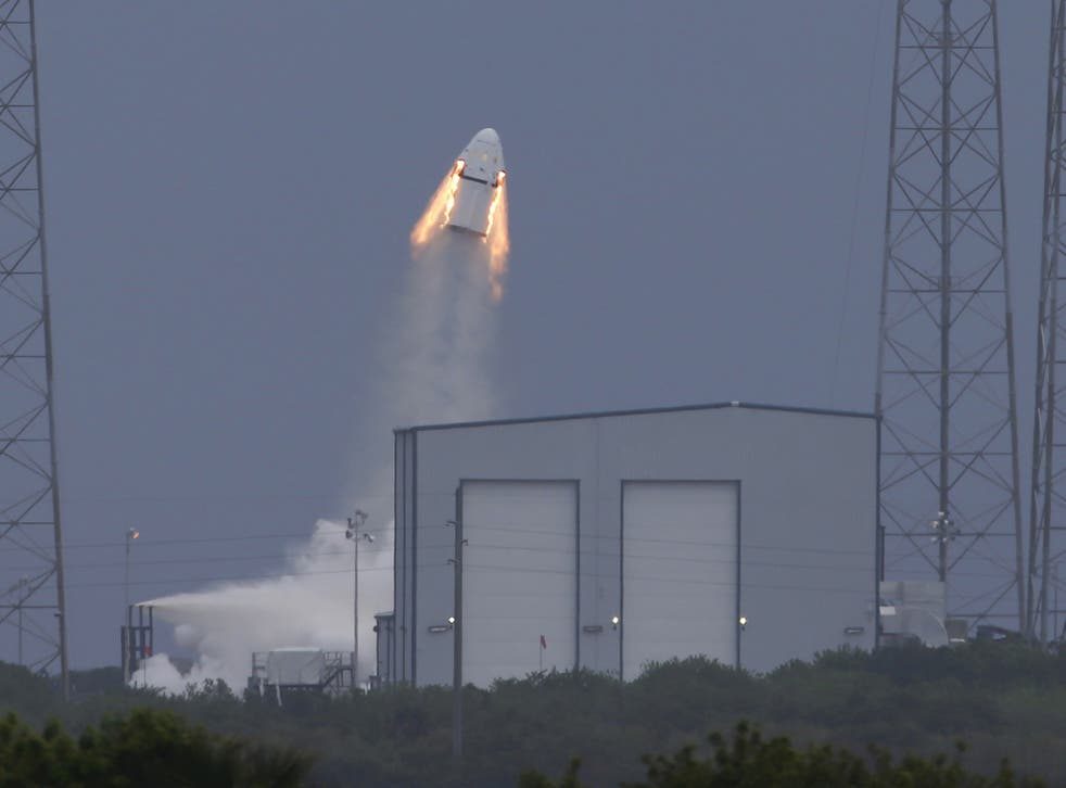 The unmanned SpaceX Crew Dragon lifts off from launch pad 40 during a Pad Abort Test at the Cape Canaveral Air Force Station in Cape Canaveral, Florida May 6, 2015