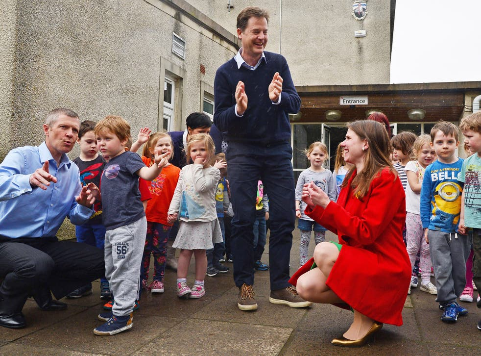 Nick Clegg, with the leader of the Scottish Lib Dems Willie Rennie (left), and parliamentary candidate Jo Swinson, at the Westerton Nursery in Bearsden, near Glasgow, on Wednesday