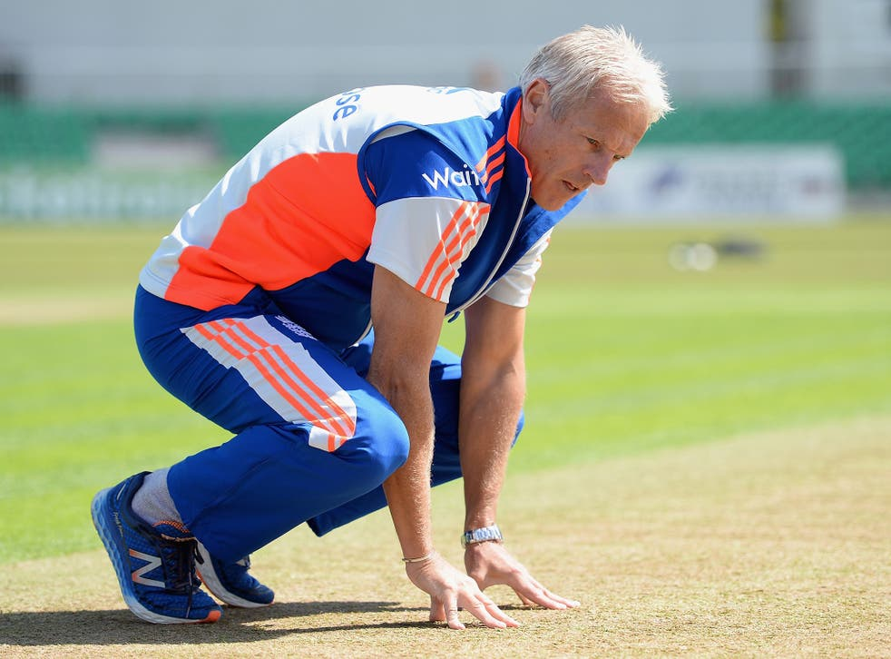 Under pressure England cricket coach Peter Moores inspects the pitch at Malahide, near Dublin, ahead of today's one-day international against Ireland