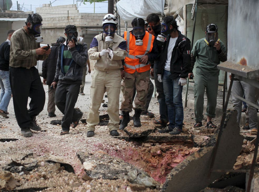 Syria's Civil Defence members after what activists claim was an earlier chemical attack on 3 May