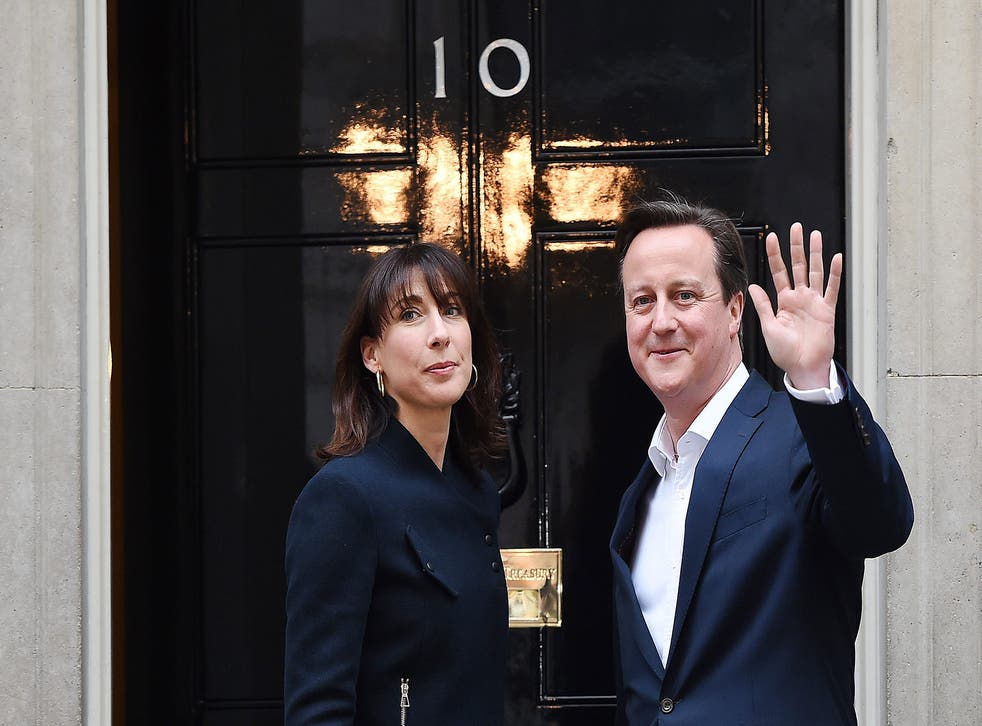 Prime Minister David Cameron and his wife Samantha arrive to N10 Downing street in London