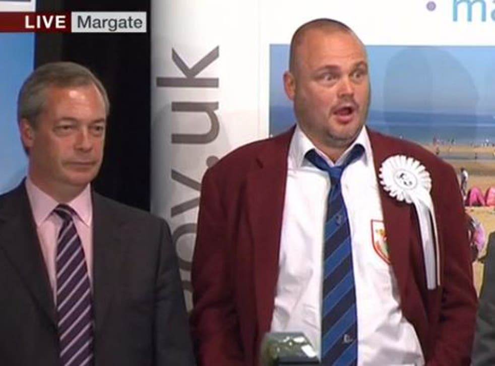Al Murray looks shocked as he hears his 318 votes won't be enough to return him to Parliament