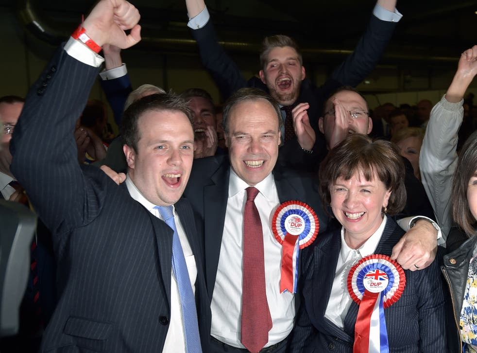 DUP Wesminster leader Nigel Dodds (C) celebrates with his wife Diane Dodds (R) after his win