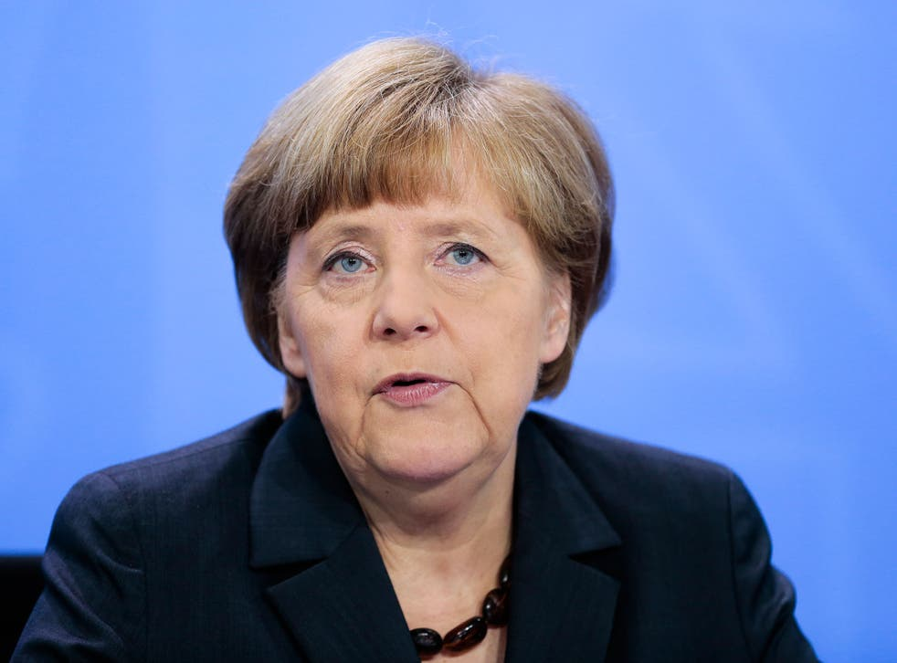 Chancellor Angela Merkel, pictured at a news conference yesterday, is said to have known about German co-operation with the NSA