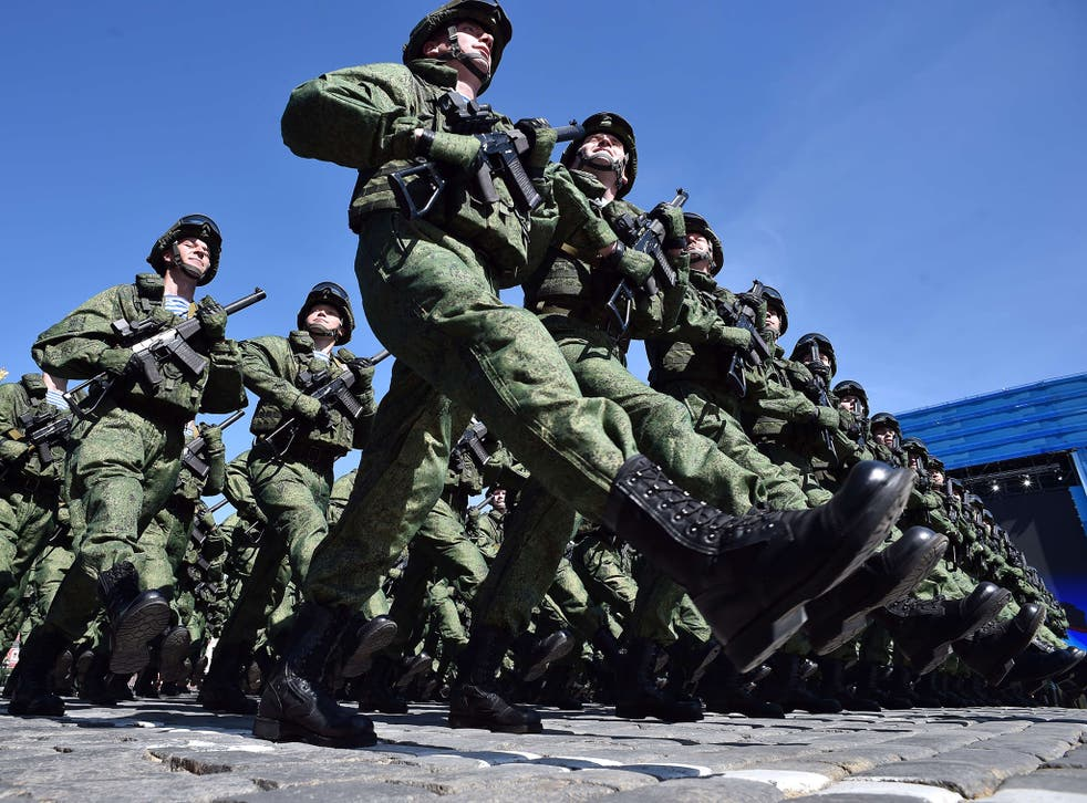 Soldiers march during a rehearsal of the Victory Day parade on Red Square