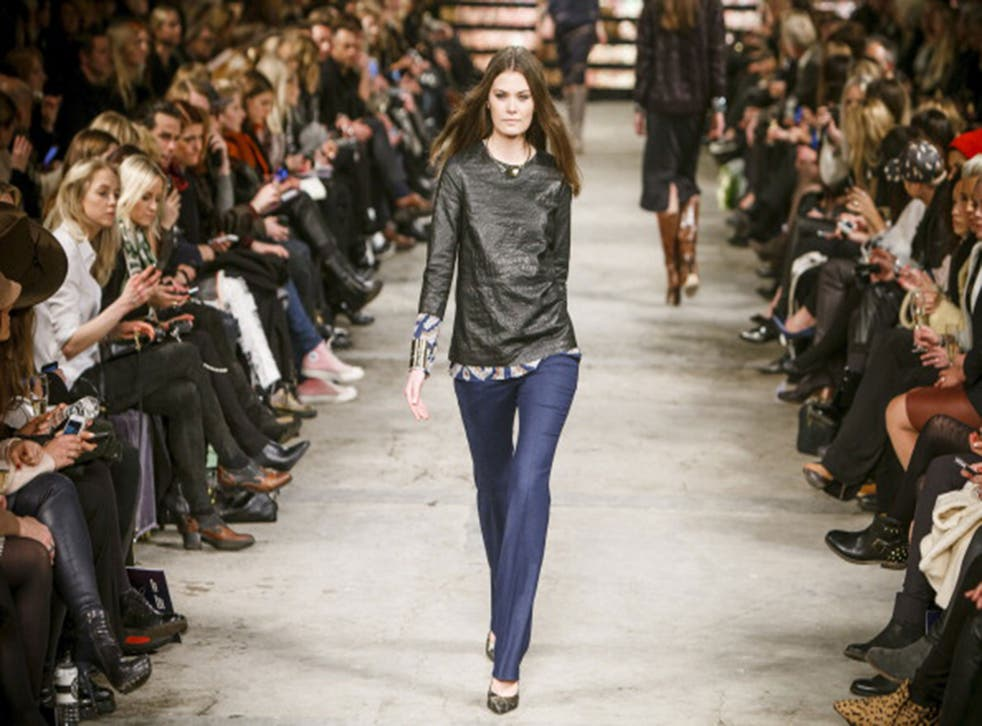A model walks the runway at Copenhagen Fashion Week
