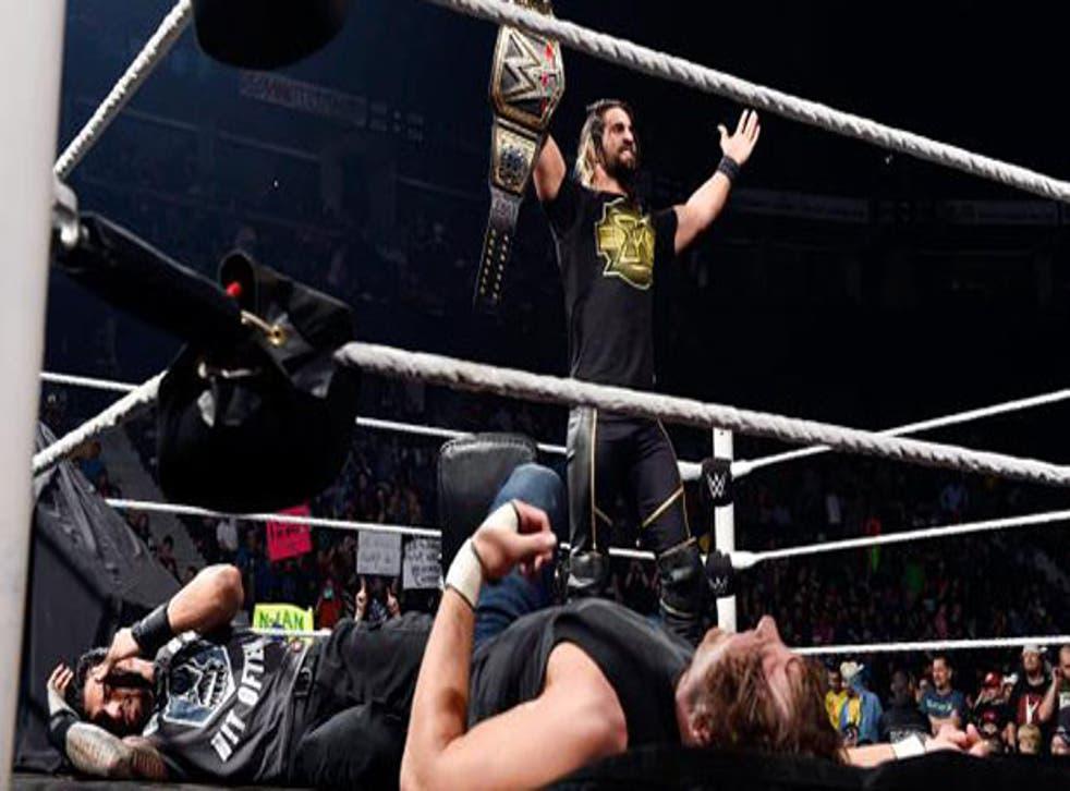 Seth Rollins shows off his WWE World Heavyweight Championship