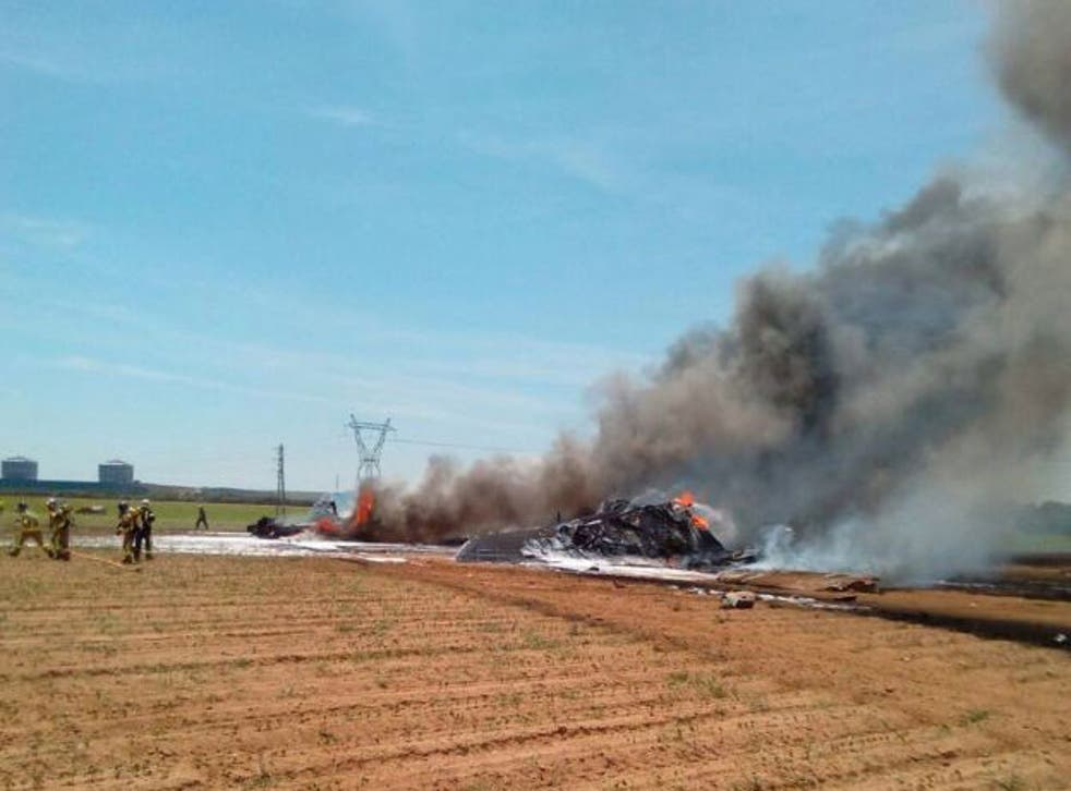 The wrekage of an Airbus A400 military plane which crashed in the San Pablo airport in Seville