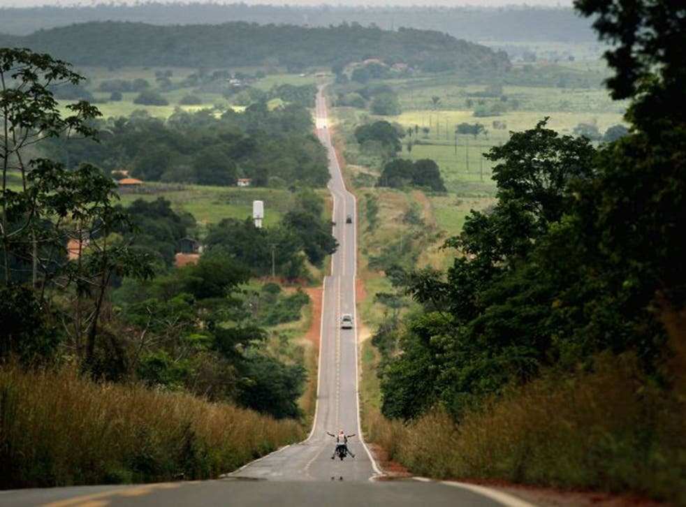 Para State drivers pass through deforested land along federal highway