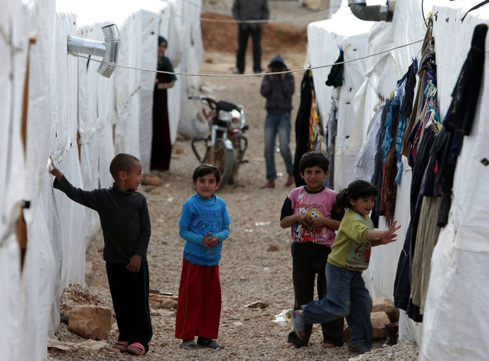 Syrian children play in one of the number of Syrian refugee camps in Lebanon (Joseph Eid)