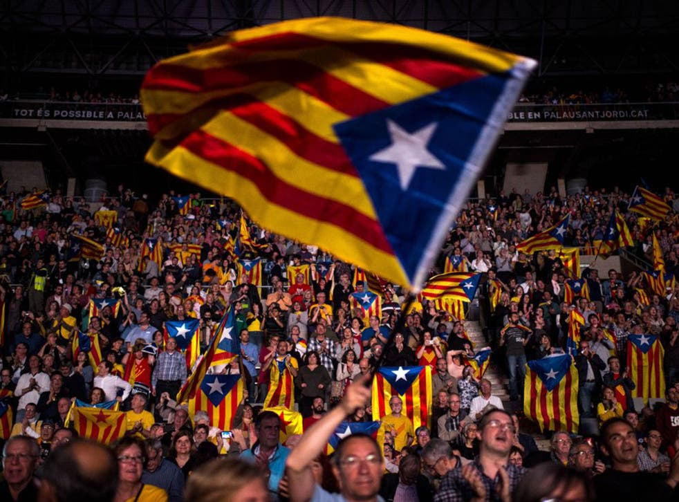 Catalan Pro-Independence supporters meet at a rally in Barcelona