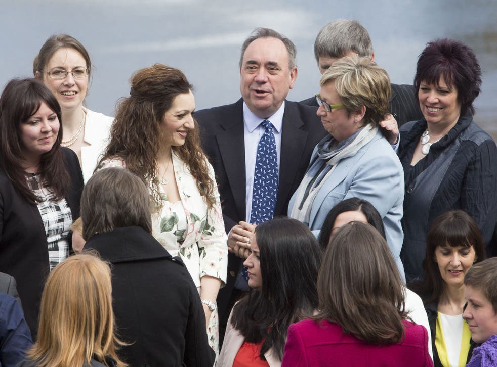 Former first minister of Scotland Alex Salmond (centre) joins fellow newly-elected SNP MPs in front of the Forth Rail Bridge in South Queensferry as the party marks its historic landslide general election victory in Scotland
