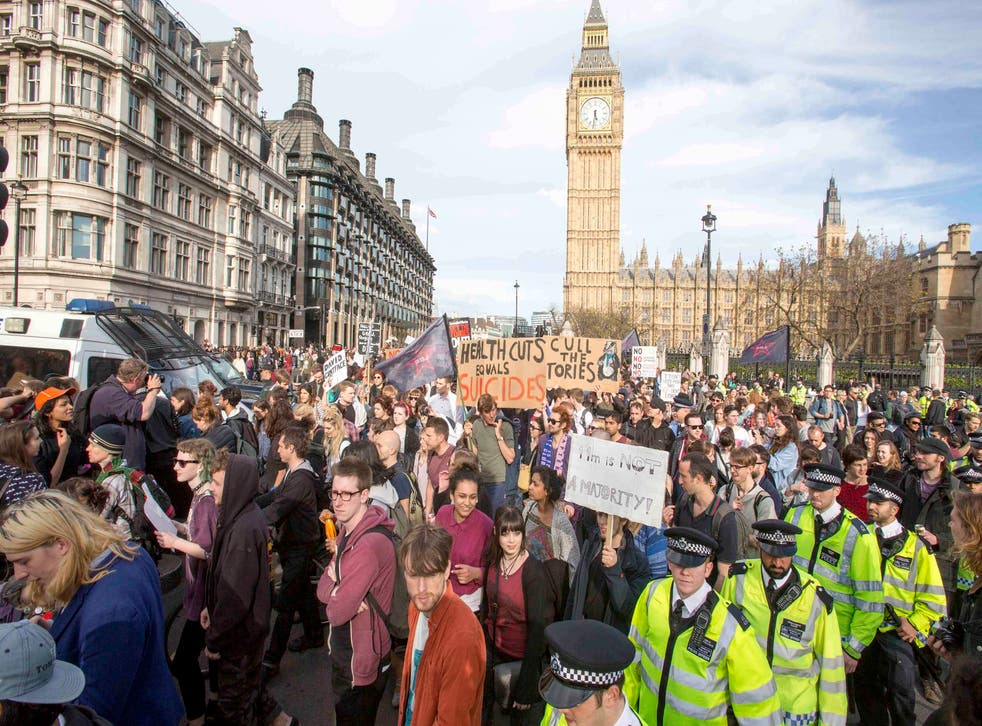 Police fight off anti-Tory protesters in Westminster two days after the election