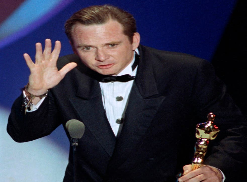 """Michael Blake accepting the Oscar for best adapted screenplay for """"Dances with Wolves"""" at the 63rd Annual Academy Awards in Los Angeles"""