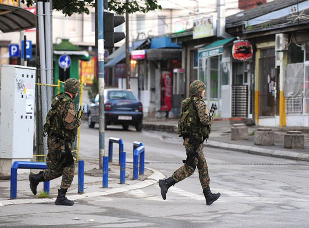 Police officers patrol in the streets of Kumanovo after armed incidents near the Kosovo border left four policemen injured