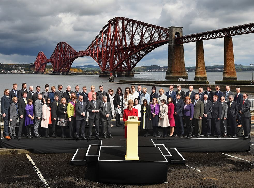Nicola Sturgeon is joined by the SNP's newly elected MPs in front of the Forth Rail Bridge