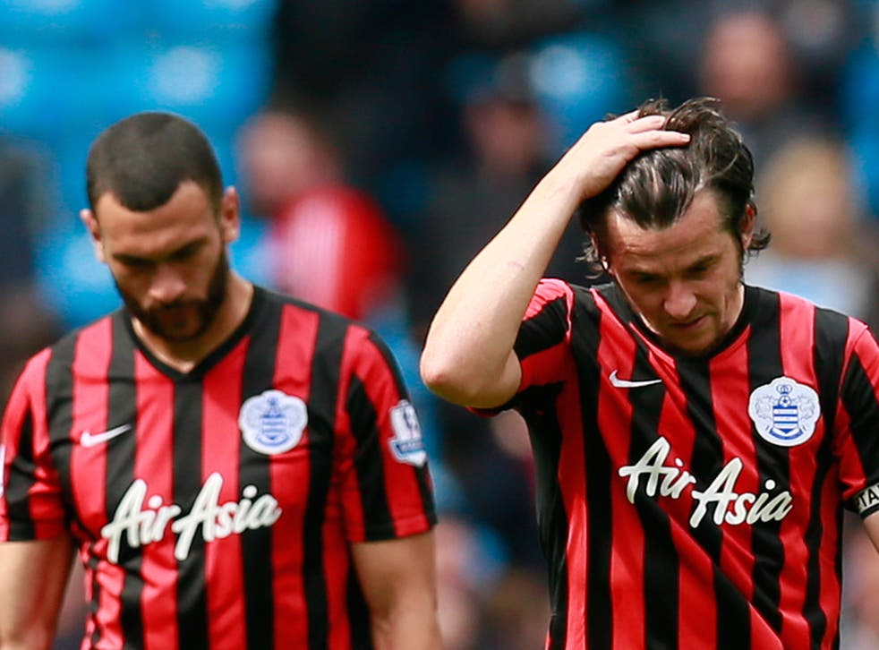 Steven Caulker and Joey Barton hang their heads after QPR are relegated from the Premier League