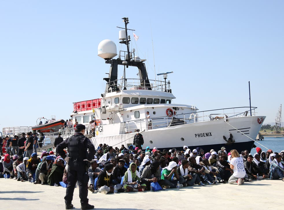 Migrants land in the harbour at Augusta, Sicily. The EU Commission is trying to devise a quota system obliging countries to share the burden of settling refugees