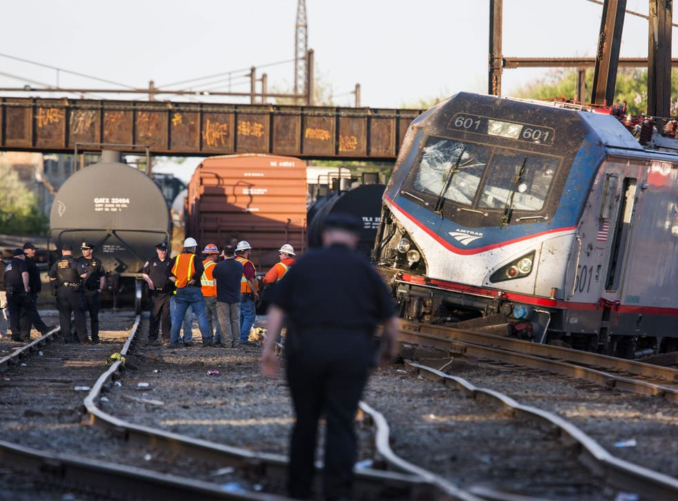 Emergency responders survey the wreckage after the crash in Philadelphia