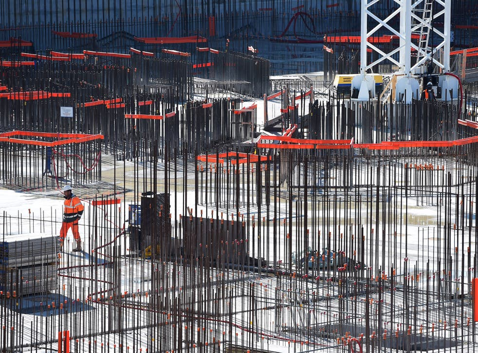A technician works at the construction site of the International Thermonuclear Experimental Reactor (ITER) on November 21, 2014 in Saint-Paul-lez-Durance, southern France