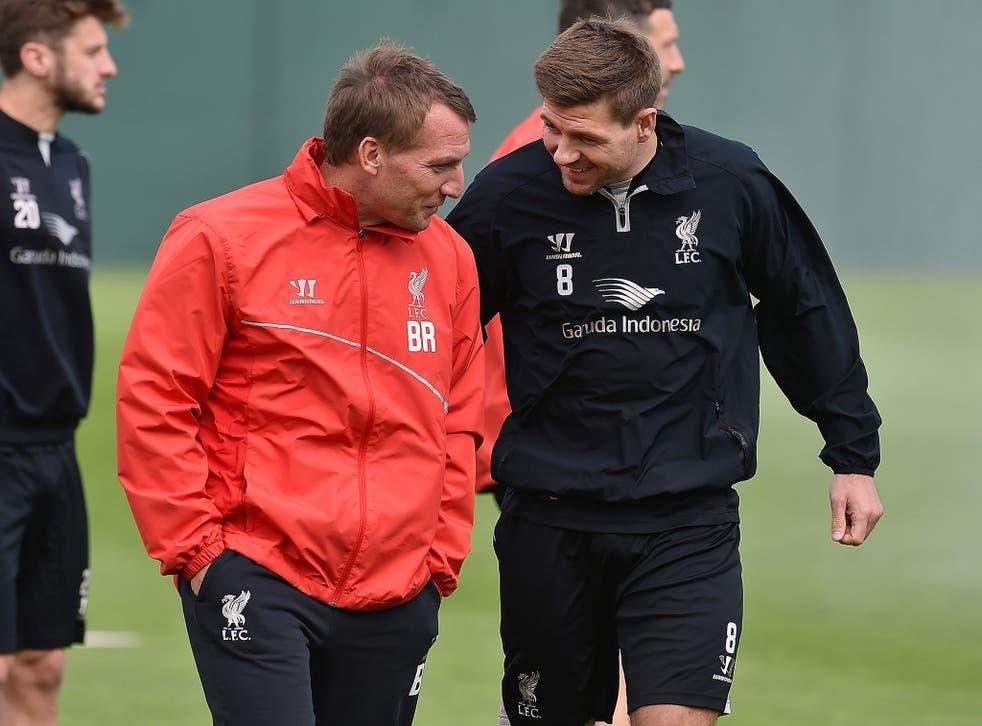 Brendan Rodgers shares a joke with Steven Gerrard