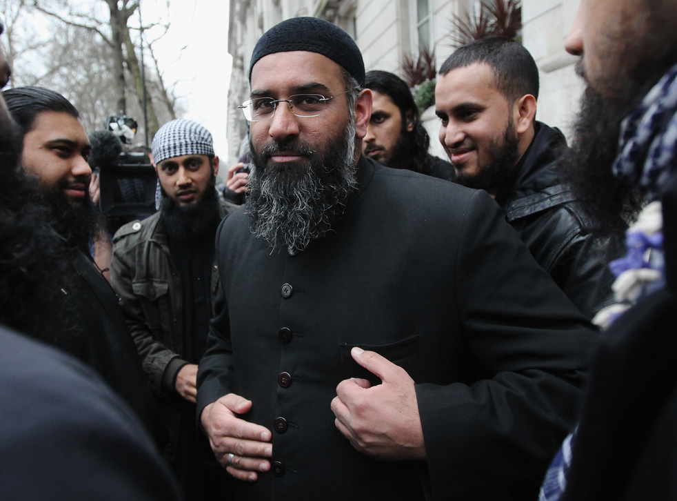Anjem Choudhary leaving a press conference in Millbank Studios