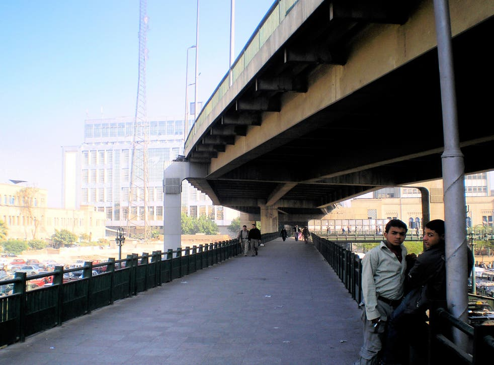 Going underground: two men pictured as part of an art project that explores people and public space in Cairo
