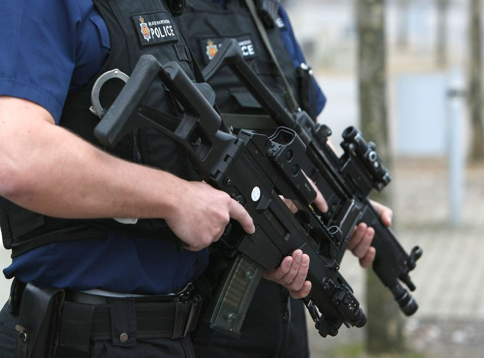 Armed response officers from Greater Manchester Police pose with Heckler and Koch G36 assualt rifles, also used by the Civil Nuclear Constabulary