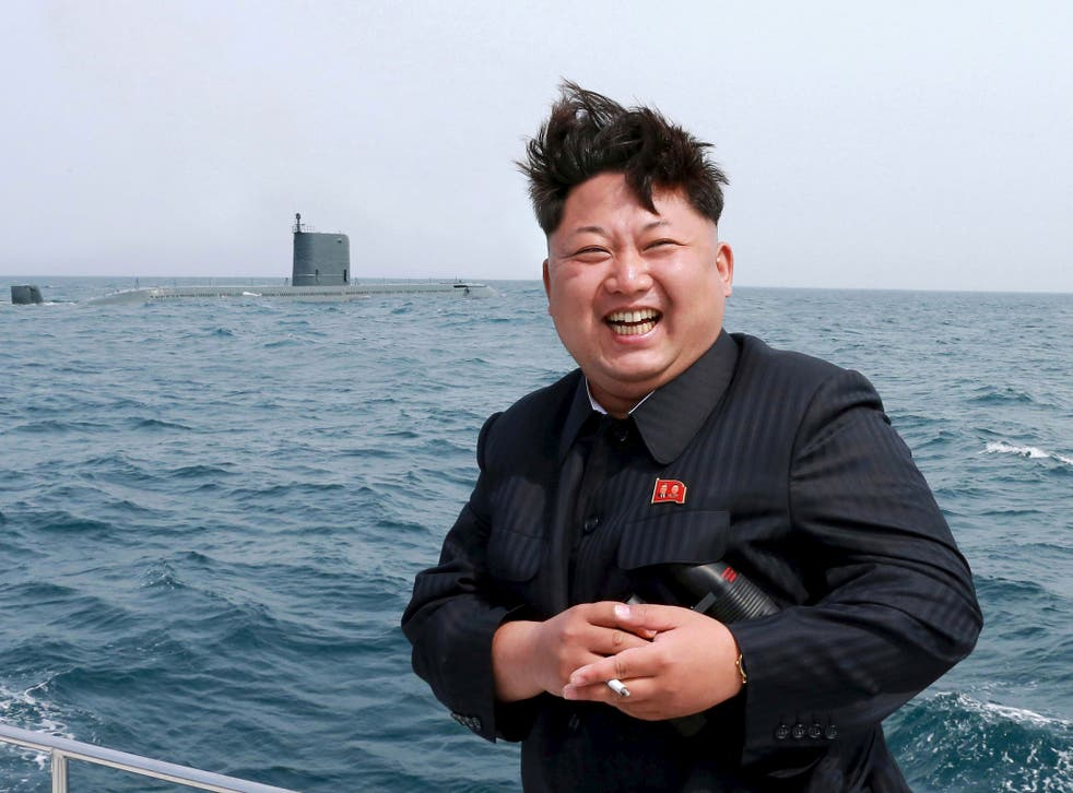 North Korean leader Kim Jong Un watches the test-fire of a strategic submarine underwater ballistic missile (not pictured), in this undated photo released by North Korea's Korean Central News Agency