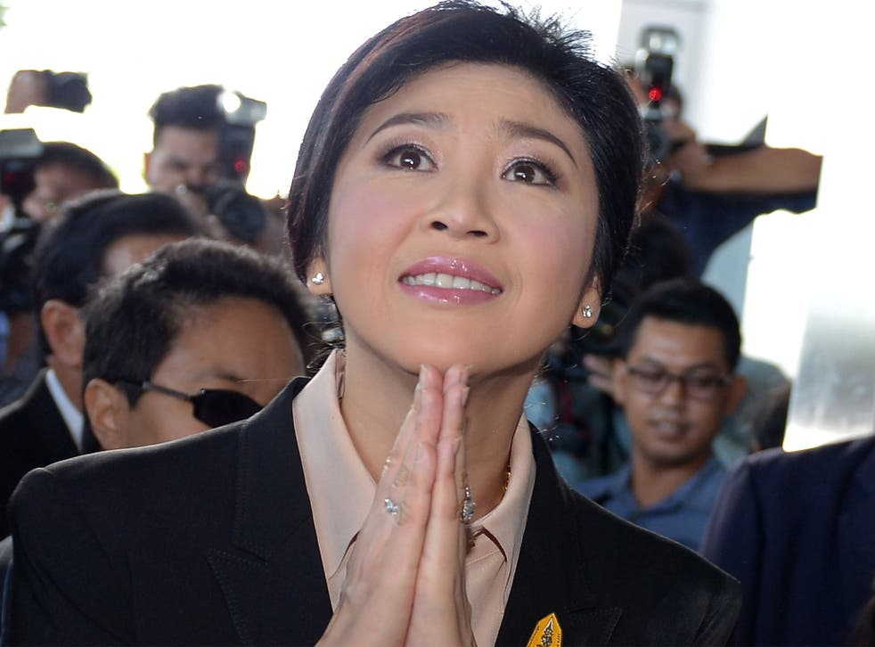 Thailand's former premier Yingluck Shinawatra arrives at the Supreme Court in Bangkok on Tuesday. She remains hugely popular in rural heartlands in the north, but is reviled by the political establishment