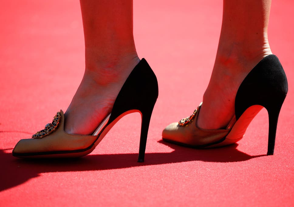 7ae7f7ae08e An attendee wears heels on the red carpet at Cannes to the press conference  for Saul