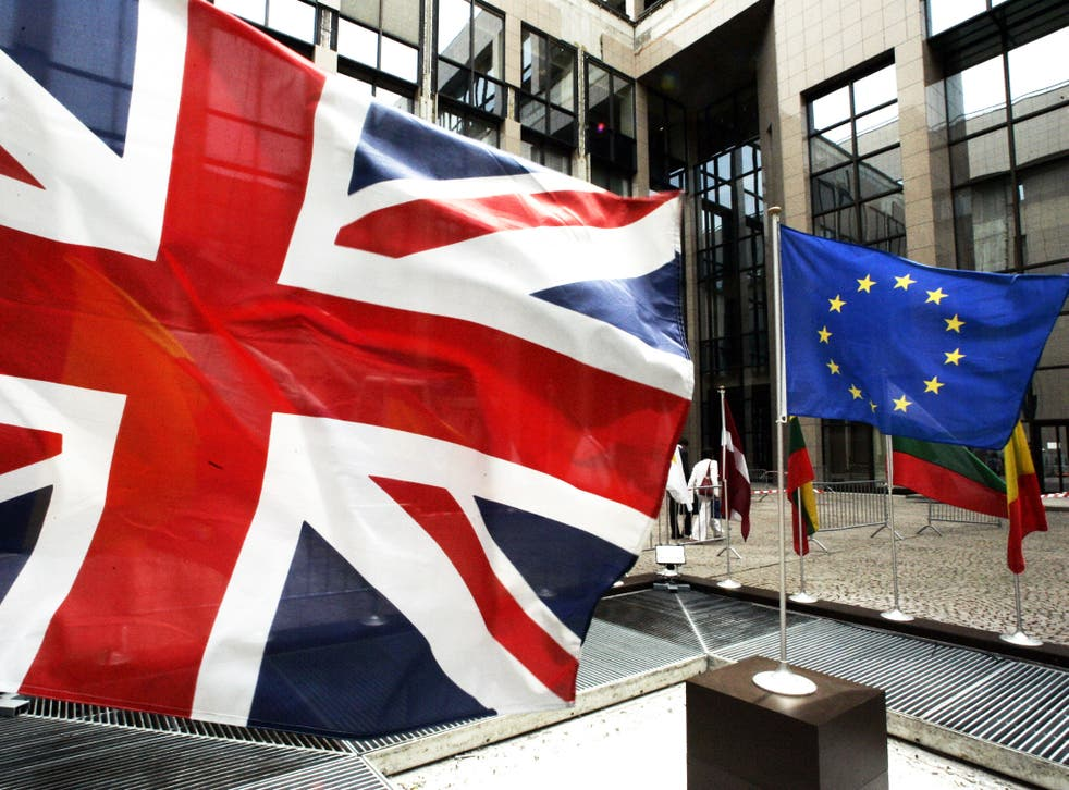 The European Union flag and the Union Jack hang outside the EU's headquarters in Brussels